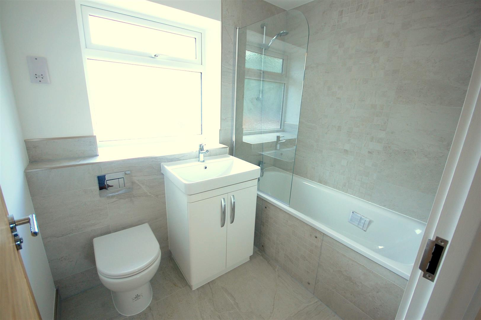 Low Level Bath. Frosted Glass Double Glazed Window To Rear Tiled ...